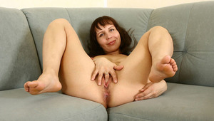 Luscious older milf gently strokes her Anilos snatch with a dildo inside her bedroom
