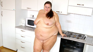 This huge woman enjoys getting horny by herself