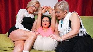 3 mature and young lesbians go kinky on the couch