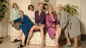 older women relaxing in a sauna