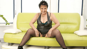 Horny old lady playing on the couch