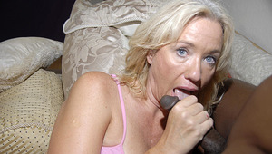 This blondy older whore just loves black dongs