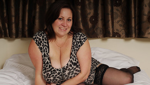 British housewife enjoys playing with her large tits