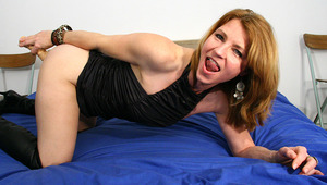 This horny MILF likes to get wet on her bed