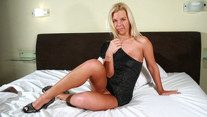This blonde MILF loves to play alone