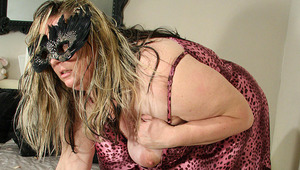 Big mama masturbating on her bed