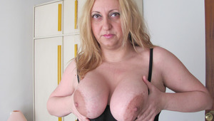 Chubby enormous breasted mama playing with a toy