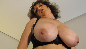 Big titted mama playing with her toys