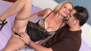 pretty cougar Cassy Torri uses her huge boobies and hot body to seduce a younger dude for a hardcore vagina pounding and a load of sperm in her mouth