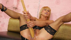 dirty yellow-haired mama getting fisted by a hot babe