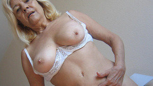 blondy older mama gets dirty with toys