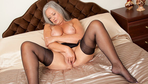 Elegant granny shows off her soft full curves and big boobies in fine lingerie then sheds it all to pummel her juicy hole with a rabbit toy