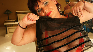 Horny cougar lady playing in the bathroom