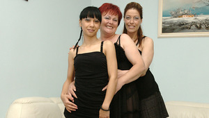 3 mature and young lesbians playing on the couch