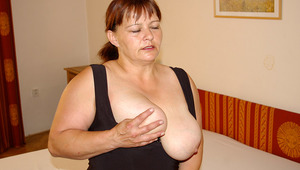 gigantic breasted mama playing on her bed