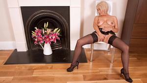 Blonde MILF Dana hides a dildo deep inside her mature muff