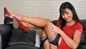 This hot mature skank enjoys to get wet on the couch