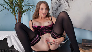 Bigtit brunette milf wearing lingerie and stockings gives herself an exam in the office